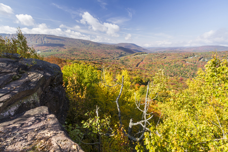 ledge: Peak Autumn Colors on Belleayre Mountain and valleys below seen from a ledge on Monka Hill in the Catskills Mountain of upstate New York. Stock Photo