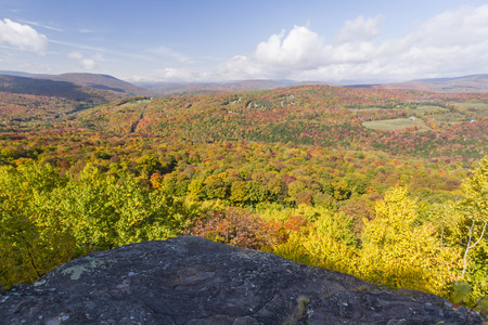 ledge: Peak Autumn Colors seen from a ledge on Monka Hill in the Catskills Mountain of upstate New York.