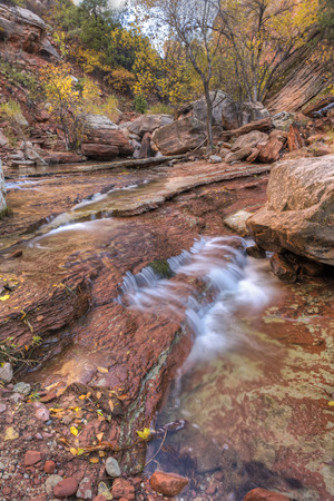 cottonwood canyon: A small red-layered falls on the Left Fork of North Creek in Zion National Park, Utah.