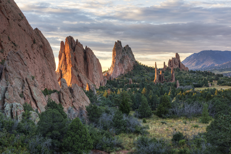 sidelight: Sunrise on the red rocks formations of the Garden of the Gods in Colorado SPring, Colorado Stock Photo