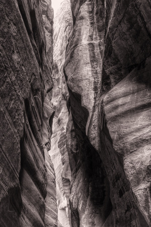 slot canyon: Light filters down to WIre Pass, a tall, narrow slot canyon that feeds into Buckskin Gulch in the Paria Canyon  Vermillion Cliffs WIlderness, near the Utah-Arizona border. Stock Photo