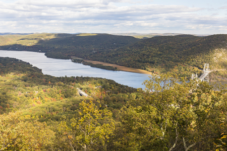mountin: Early Autumn on the Hudson River and Bear Mountain Bridge in Bear Mountin State Park, New York. Stock Photo