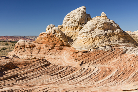 twisty: Twisty and curving rocks look like ice cream in the unique and remote White Pocket rock formations in Vermillion Cliffs National Monument in Arizona.