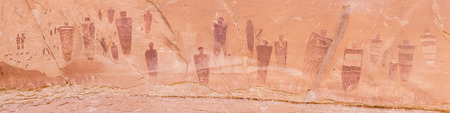 A panoramic image of the Great Gallery of Barrier Canyon petroglyphs in the remote Horseshoe Canyon Unit of Canyonlands National Park, Utah.