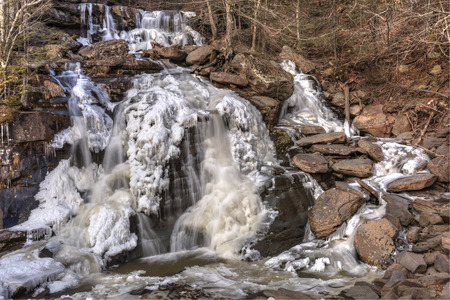 frozen creek: Half frozen Bastion Falls beside Route 23A on Lake Creek, about 12 miles downstream of Kaaterskill Falls in the Catskills Mountains of New York. (HDR)