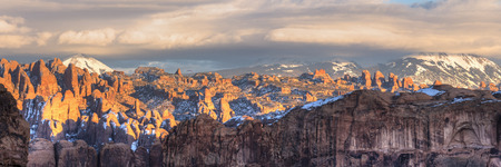 The last sunlight hits the sandstone fine in the Behind the Rocks Wilderness area witrh the La Sal Mountains behind in Moab, Utah