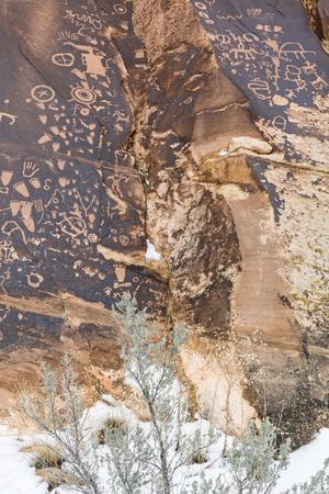 indian creek: Newspaper Rock petroglyphs in winter, at the Newspaper Rock State Historic Monument in Utah. Stock Photo