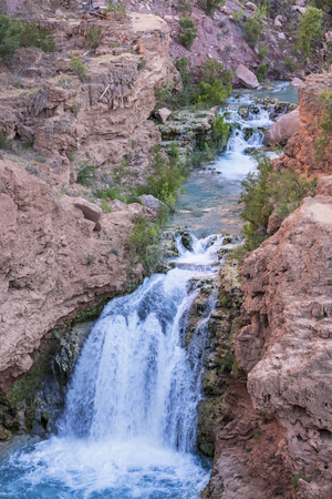indian creek: A unnamed waterfall cuts through Havasu Canyon on the Havasupai Indian Reservation in the Grand Canyon.