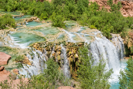 indian creek: Water from Havasu Creek flows over travertine pools and rushes over Little Navajo Falls on the Havasupai Indian Reservation in the Grand Canyon. Stock Photo