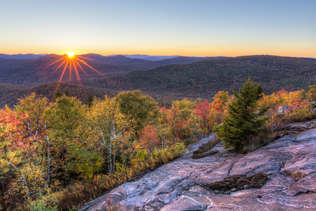 Colorful Autumn Sunset over Seneca Mountain from an overlook on Hadley Mountain in the Adirondack Mountains of New York Stok Fotoğraf