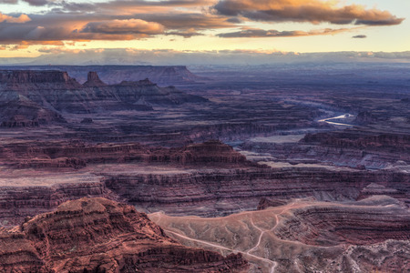 The Colorado River snakes through the canyonlands below Dead Horse Point at dusk. Stock Photo
