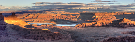 Potash evaporation ponds and the Behind the Rocks formations see from Dead Horse Point at sunset point near Moab, Utah. Stock Photo