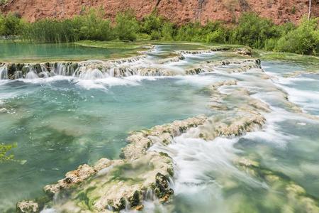 indian creek: The crystal clear turquoise waters of Havasu Creek flow over travertine terraces forming pools in Havasupai Indian Reservation, Arizona.