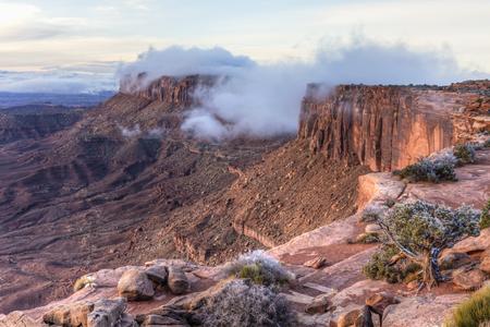 Fog envelops Junction Butte seen from Grand Viewpoint in Canyonlands National Park, Utah