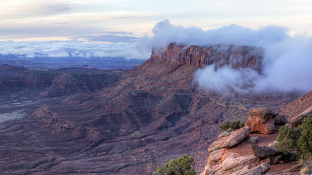 Fog envelops Junction Butte seen from Grand Viewpoint in Canyonlands National Park, Utah