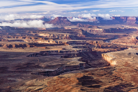 Morning fog burning off in Soda Springs Basin, seen from the Green River Overlook in Canyonlands National Park, Utah