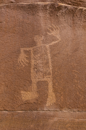 defaced: A petroglyph image of the Wolfman on the cliffs of Butler Wash in the Comb Ridge aea of the new Bears Ears National Monument. Stock Photo
