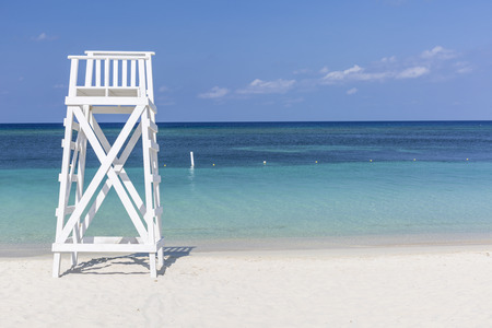 A white lifeguard tower near the tranquil waters off West Bay Beach in West Bay, Roatan, Hoduras
