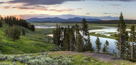 Panoramic image of sunset in the Hayden Valley reflected in the Yellowstone River in Yellowstone National Park, Wyoming.