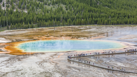 Tourists line the boardwalk at the Grand Prismatic Spring in Midway Geyser Basin, seen from above in Yellowstone National Park, Wyoming. Editorial