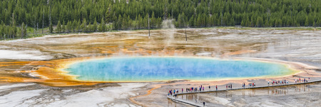 Tourists line the boardwalk at the Grand Prismatic Spring in Midway Geyser Basin in Yellowstone National Park, Wyoming.