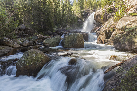 Sunbeams in the mist from Alberta Falls in Glacier Gorge in Rocky Mountain National Park, Colorado Stock Photo