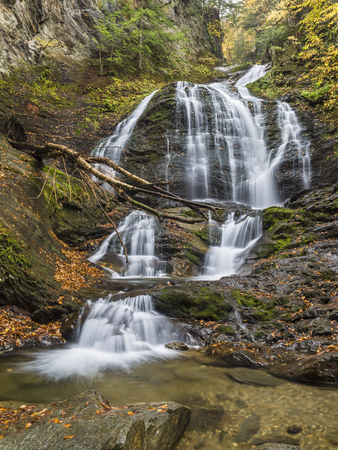 Moss Glen Falls in Autumn seen from the pool below in Stowe, Vermont