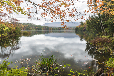 A calm foggy Autumn morning on the Waterbury Reservoir in Waterbury, Vermont. Stock Photo