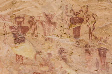 Mysterious, perhaps extra-terrestrial figures on a Barrier Canyon Style pictograph on the cliff walls of Sego Canyon Utah.