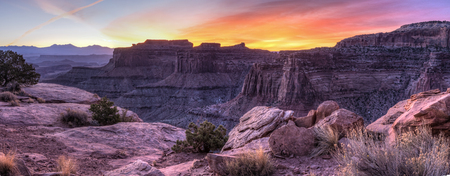 Colorful sunrise over Shafer Canyon, off the Shaefer Trail in Canyonlands National Park, Utah.