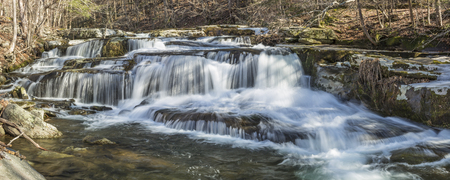 Panoramic image of a multi-tiered waterfalls on Stony Clove Creek in Greene Country in the Catskill Mountains in Edgewood, New York Stock Photo