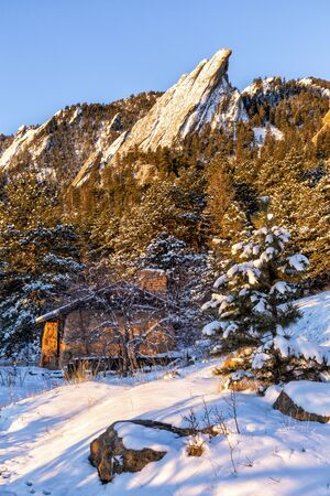 A fresh coating of snow coats the Flations rock formations, seen from Chautauqua Park in Boulder, Colorado Stock Photo