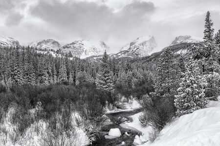 Morning lights hits Taylor, Otis, Hallett and Flattop Peaks above Glacier Creek after a late Spring snow in Rocky Mountain National Park, Estes Park, Colorado.