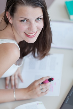 close-up of a pretty female college student studying in the university library/study room Stock Photo - 9692141
