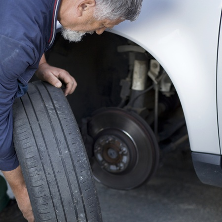 mechanic changing a wheel of a modern car Stock Photo - 9692139