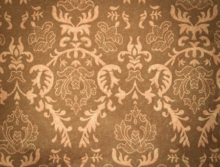 antiek behang: vervaagde bruine vintage achtergrond met damast-achtig sier patroon Stockfoto