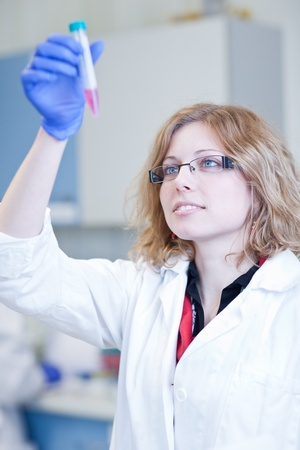 portrait of a female researcher doing research in a lab (shallow DOF; color toned image) Stock Photo - 9791985