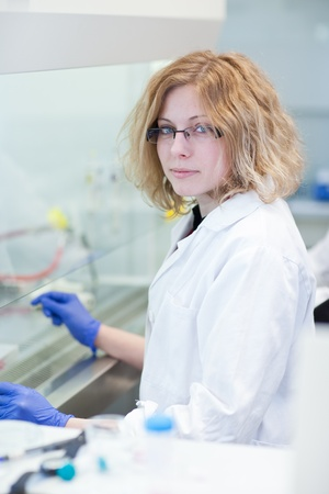 portrait of a female researcher doing research in a lab (shallow DOF; color toned image) Stock Photo - 9791983