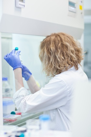 portrait of a female researcher doing research in a lab (shallow DOF; color toned image) Stock Photo - 9697034