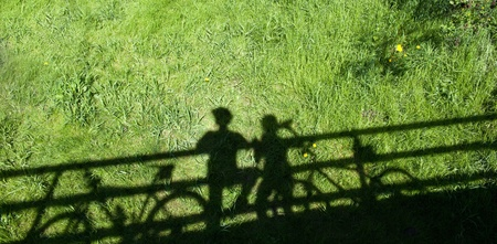 halt: cycling related background - two mountain bikers silhouettes during a halt on a bridge