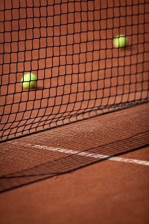 Tennisballen op de baan