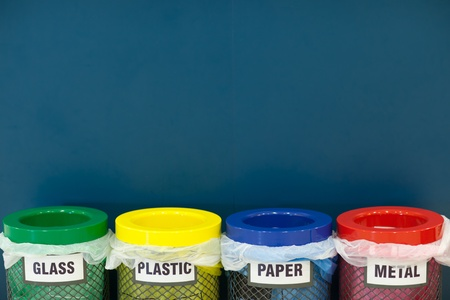 recycling bins: waste disposal series - colorful recycle bins (color toned image; shallow DOF) Stock Photo