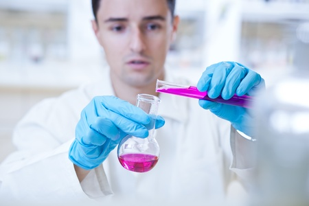 close-up portrait of a young male researcher carrying out experiments in a research lab photo