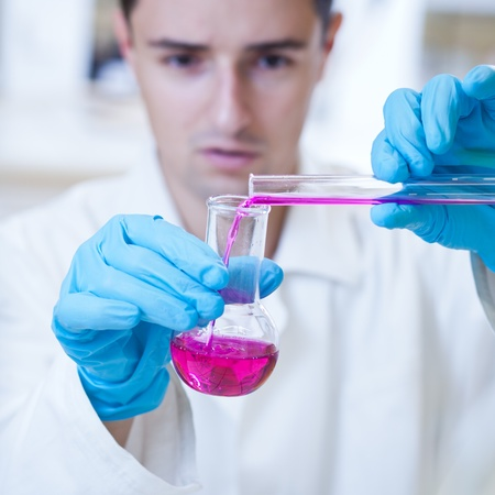 close-up portrait of a young male researcher carrying out experiments in a research lab  Stock Photo - 9697935