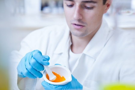 close-up portrait of a young male researcher carrying out experiments in a research lab  Stock Photo - 9697228