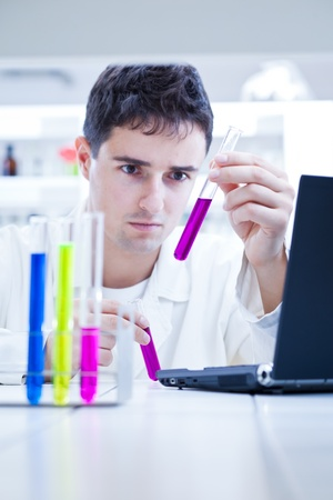 close-up portrait of a young male researcher carrying out experiments in a research lab  Stock Photo - 9697225