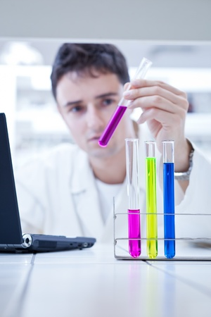 close-up portrait of a young male researcher carrying out experiments in a research lab Stock Photo - 9697211