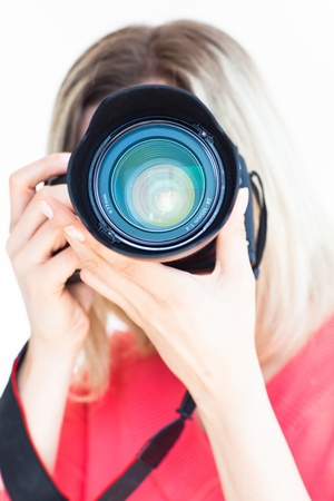 pretty female photographer with her digital camera (color toned image; shallow DOF) Stock Photo - 9697330