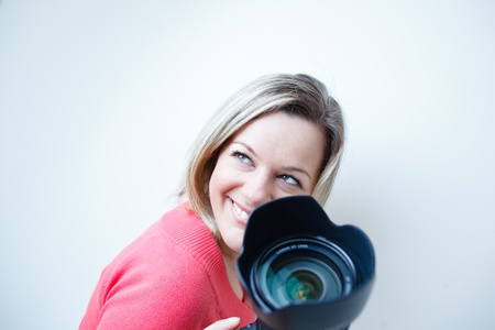 pretty female photographer with her digital camera (color toned image; shallow DOF) Stock Photo - 9795418