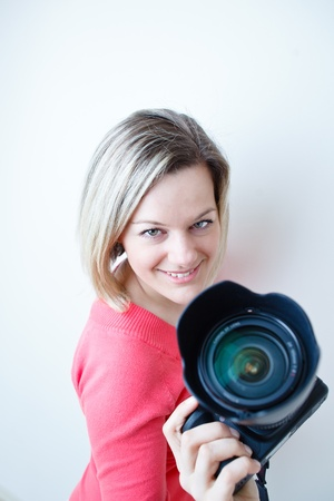 pretty female photographer with her digital camera (color toned image; shallow DOF) Stock Photo - 9795409